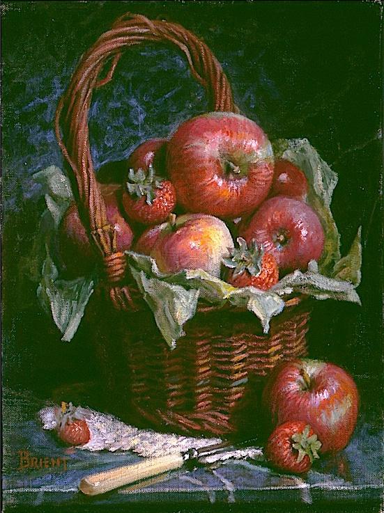 Un panier de pommes sur un fond de marbre foncé