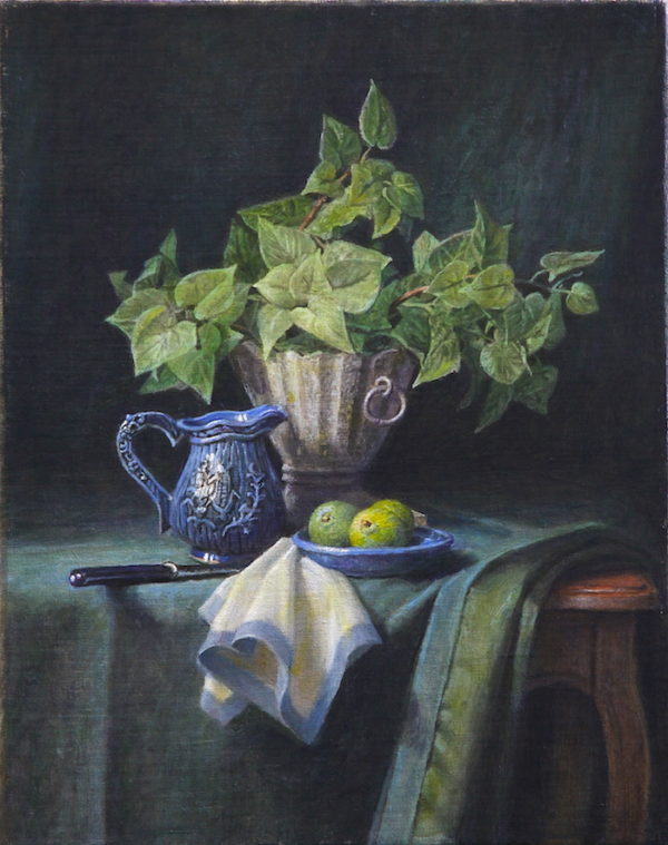 A Green plant and a plate of limes