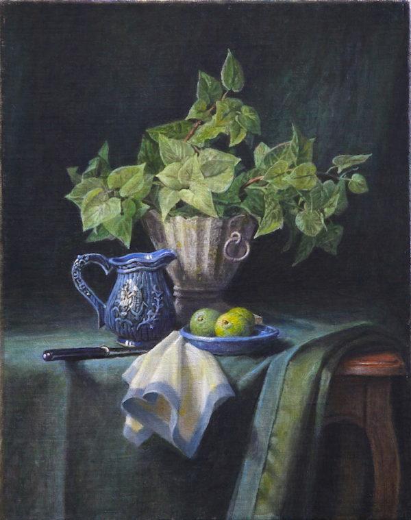 Une plante verte et une assiette de limes