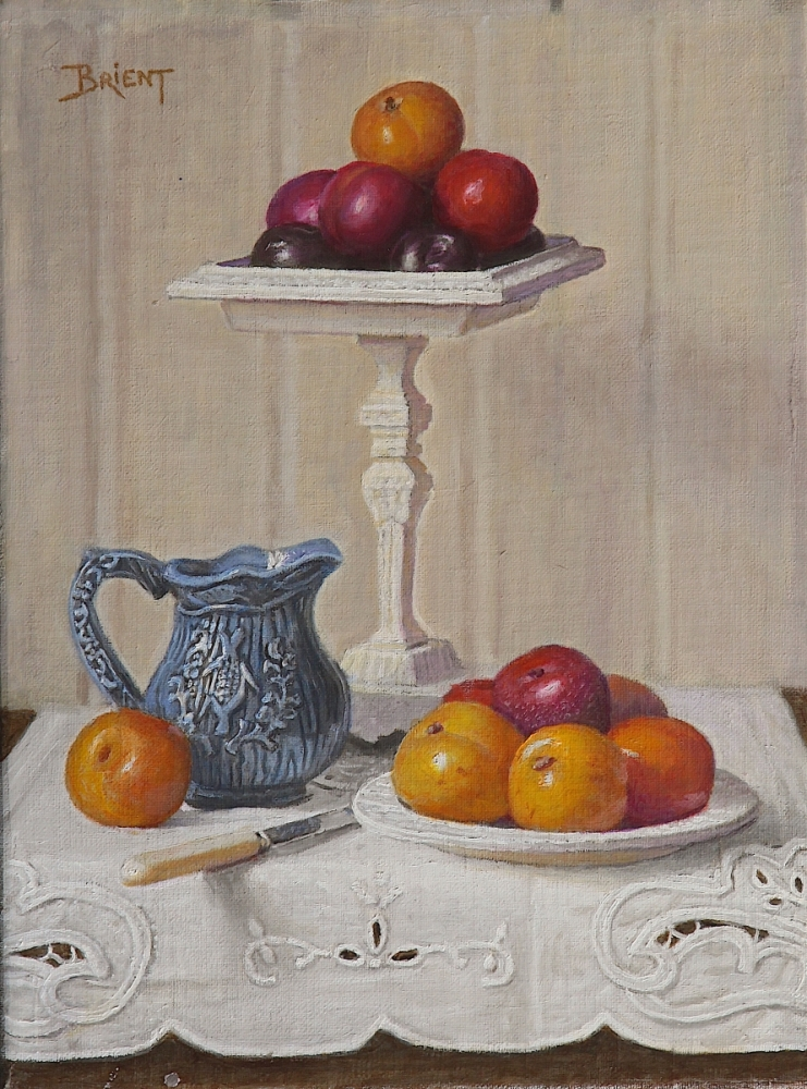 A compotier with plums, a plate of plums, a small blue pitcher