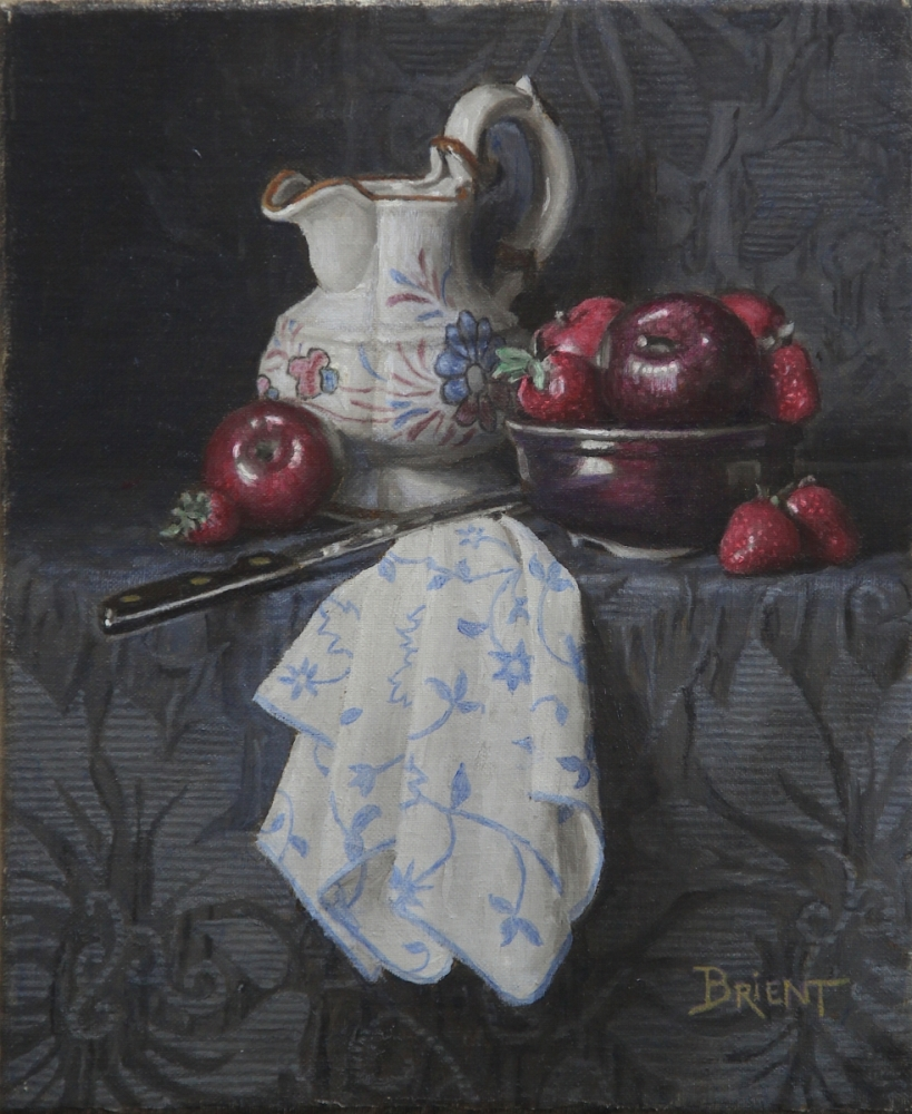 A white jug, a bowl of apples and strawberries, a white napkin