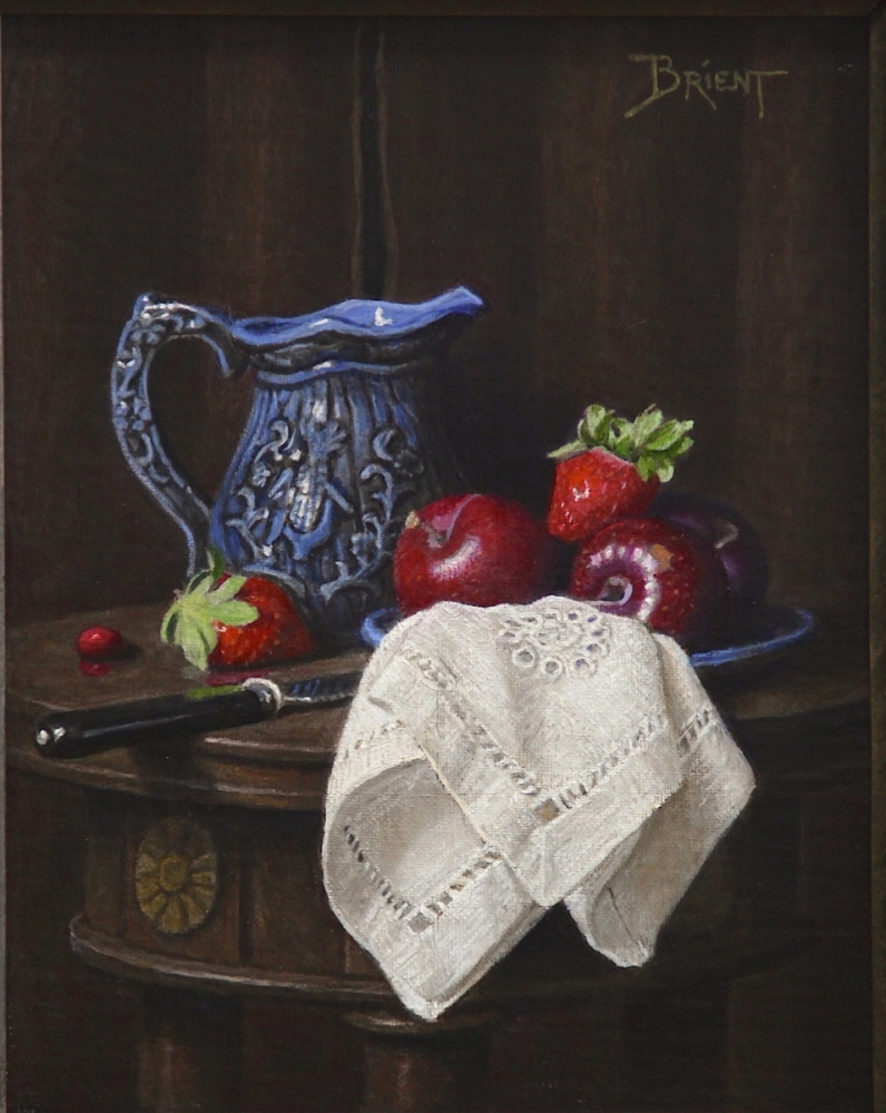 A little blue jug with red fruits