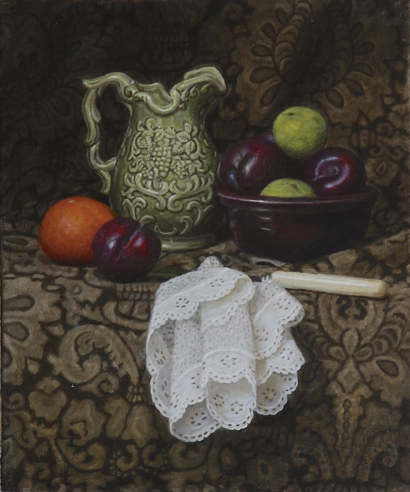 A green jug, a bowl of plums and limes, an orange