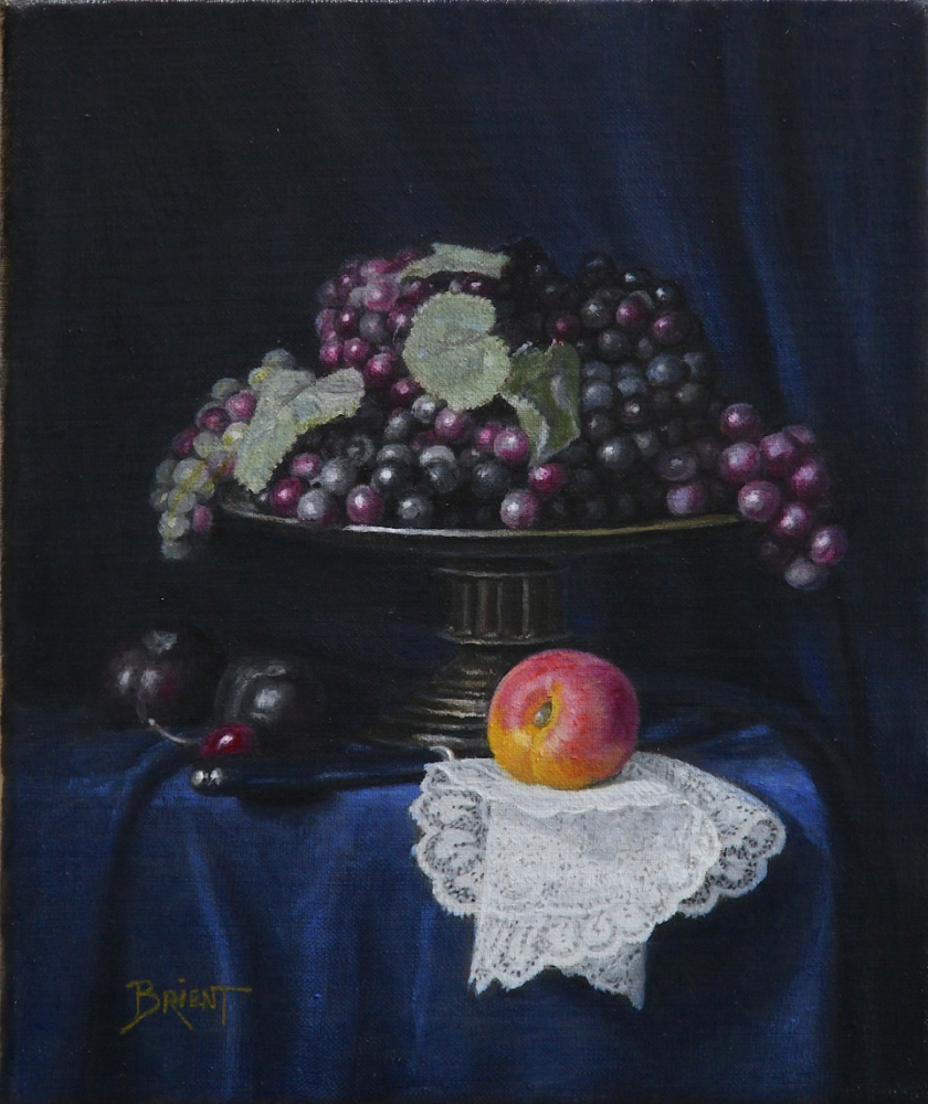 A large plate of grapes, plums, an apricot