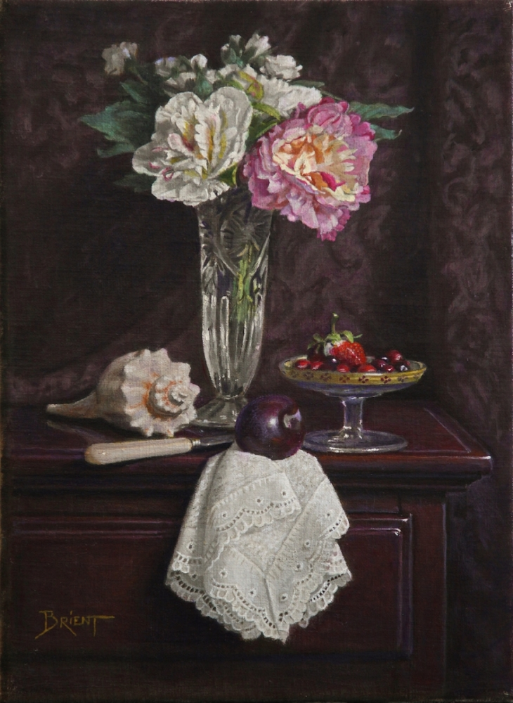 A vase of flowers, a little plate of small fruits and a sea shell